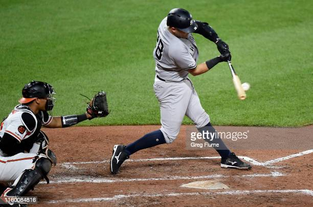 Austin Romine of the New York Yankees hits a two-run double in the fourth inning against the Baltimore Orioles at Oriole Park at Camden Yards on...