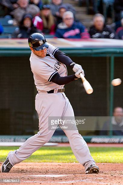 Austin Romine of the New York Yankees hits an RBI single during the sixth inning against the Cleveland Indians during the second game of a...