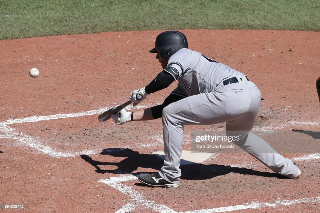Austin Romine #28 of the New York Yankees lays down a sacrifice bunt in the tenth inning during MLB game action against the Toronto Blue Jays at Rogers Centre on July 8, 2018 in Toronto, Canada.