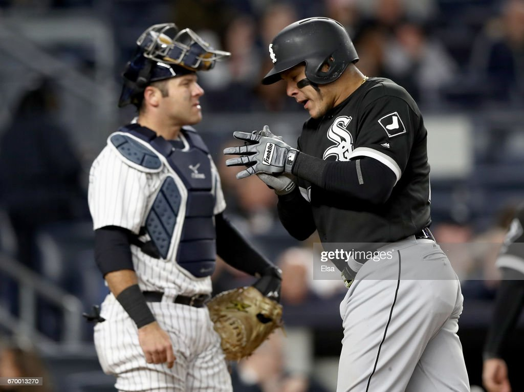 Austin Romine #27 of the New York Yankees reacts as Avisail Garcia #26 of the Chicago White Sox celebrates his three run home run in the seventh inning on April 18, 2017 at Yankee Stadium in the Bronx borough of New York City.