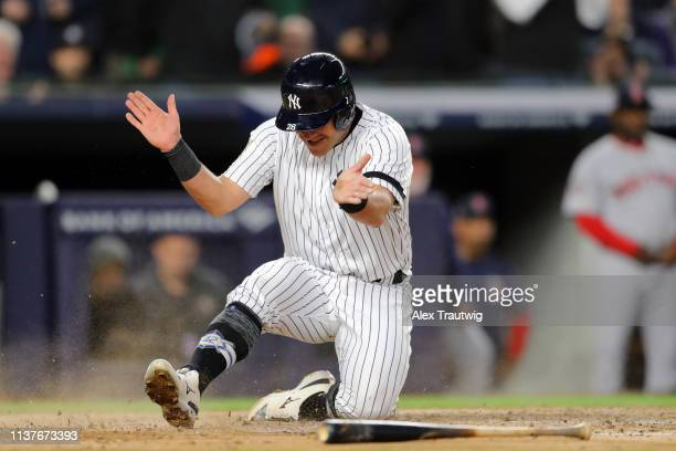 Austin Romine of the New York Yankees reacts to scoring a run in the fourth inning during the game between the Boston Red Sox and the New York...