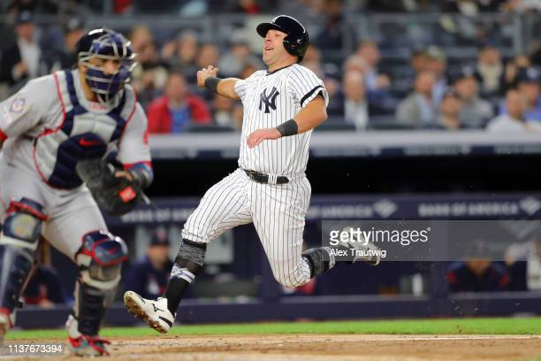 Austin Romine of the New York Yankees scores a run in the fourth inning during the game between the Boston Red Sox and the New York Yankees at Yankee...