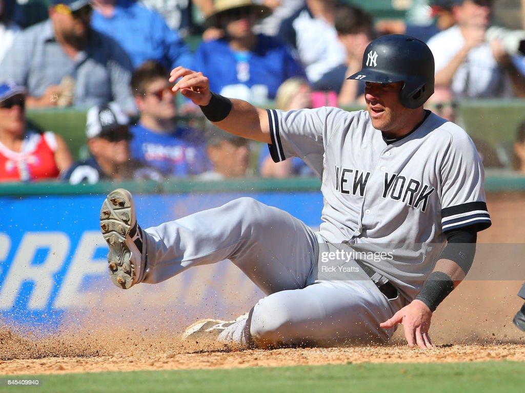 Austin Romine #27 of the New York Yankees slides in safe in the fourth inning against the Texas Rangers at Globe Life Park in Arlington on September 10, 2017 in Arlington, Texas.