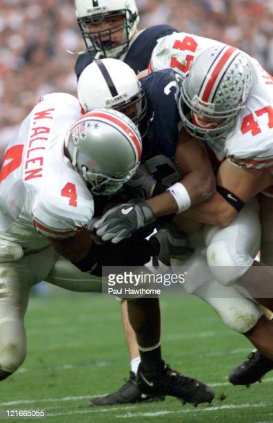 Austin Scott of Penn State is crunched by Ohio State defenders Will Allen and AJ Hawk during first half action at Beaver Stadium University Park...