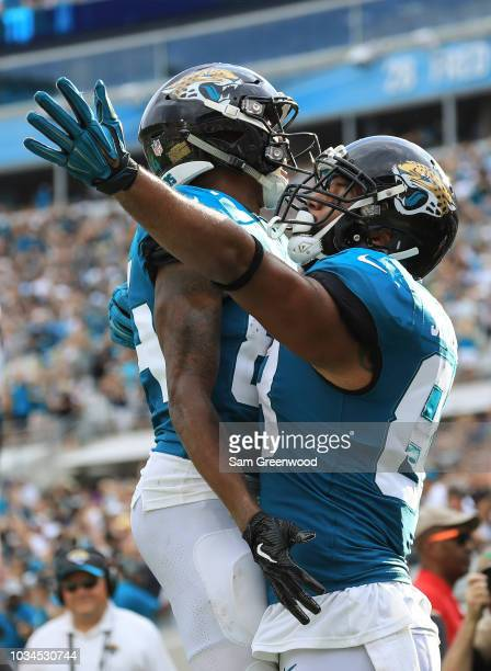 Austin SeferianJenkins of the Jacksonville Jaguars celebrates a touchdown reception with teammates during the first half against the New England...