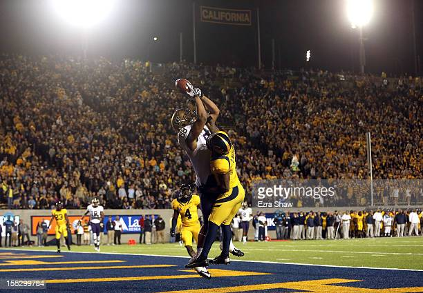 Austin Seferian-Jenkins of the Washington Huskies catches a touchdown pass while defended by Steve Williams of the California Golden Bears at...