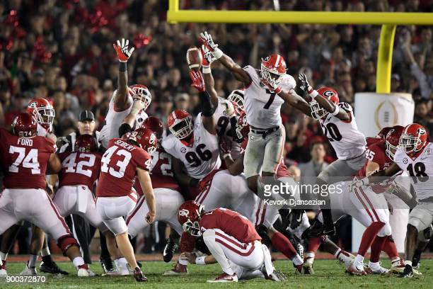 Austin Seibert of the Oklahoma Sooners attempts the field goal but is blocked by Lorenzo Carter of the Georgia Bulldogs in the 2018 College Football...