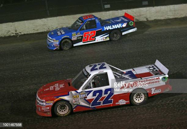 Austin Self driver of the GO TEXAN Chevrolet and Stewart Friesen driver of the We Build America Chevrolet race during the NASCAR Camping World Truck...