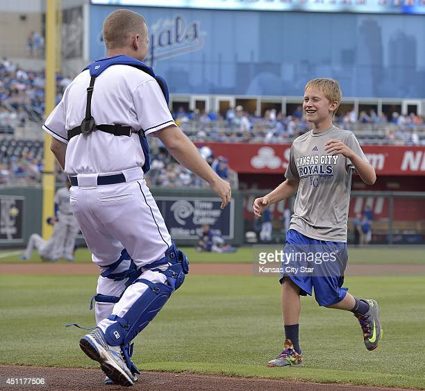 Austin Sides from Lansing Kan runs into the arms of his father Air Force Major Robert Sides who was hiding in full catcher gear for Austin's...