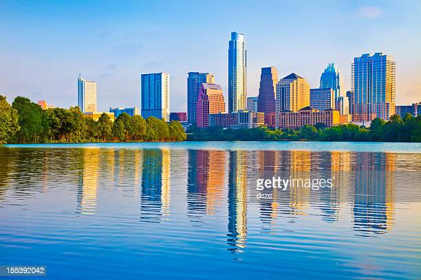austin skyline at sunrise reflected in ladybird lake - austin texas stock pictures, royalty-free photos & images