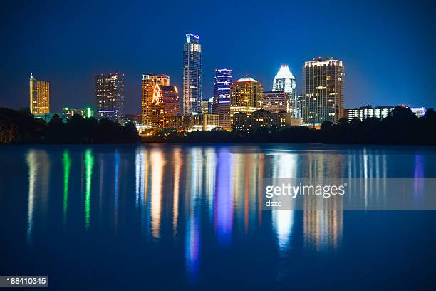 austin skyline cityscape at night reflected in ladybird lake - austin texas stock pictures, royalty-free photos & images