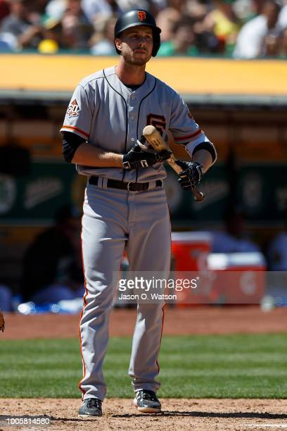 Austin Slater of the San Francisco Giants at bat against the Oakland Athletics during the seventh inning at the Oakland Coliseum on July 22 2018 in...
