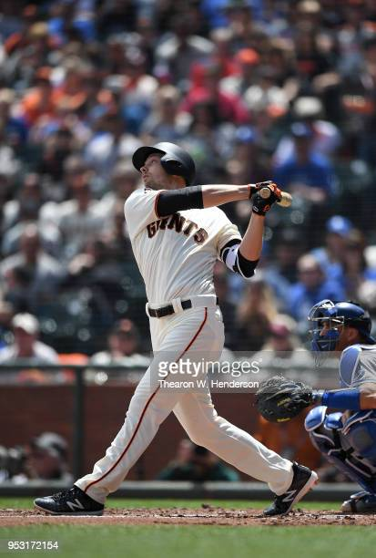 Austin Slater of the San Francisco Giants bats against the Los Angeles Dodgers in the bottom of the first inning of game one of a double headers at...