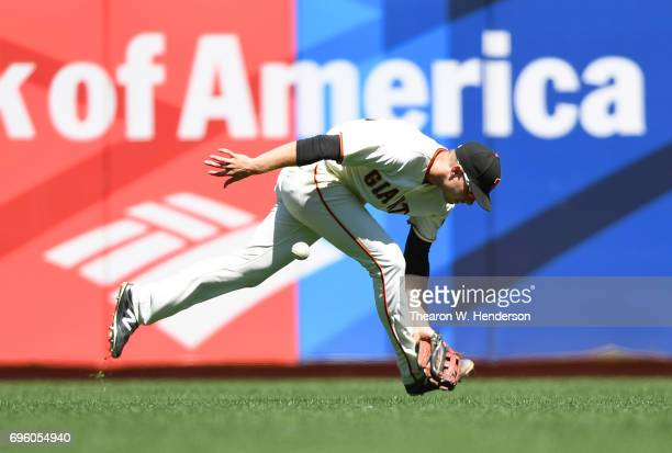 Austin Slater of the San Francisco Giants can't make the catch in this ball that goes for an rbi single off the bat of Lorenzo Cain of the Kansas...