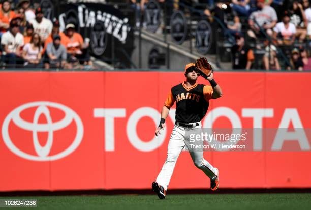 Austin Slater of the San Francisco Giants catches a fly ball against the Texas Rangers in the top of the eighth inning at ATT Park on August 25 2018...