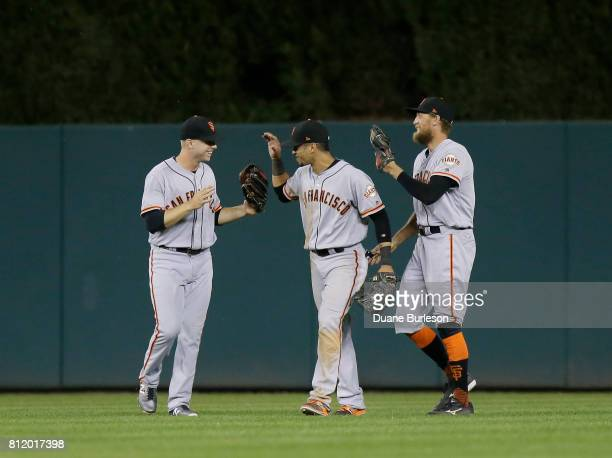 Austin Slater of the San Francisco Giants celebrates a win over the Detroit Tigers with Gorkys Hernandez of the San Francisco Giants and Hunter Pence...