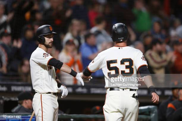 Austin Slater of the San Francisco Giants celebrates with teammate Steven Duggar after scoring a run in the fifth inning against the Pittsburgh...