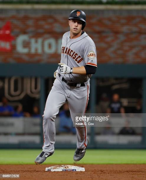Austin Slater of the San Francisco Giants crosses second base after hitting a threerun homer in the eighth inning against the Atlanta Braves at...