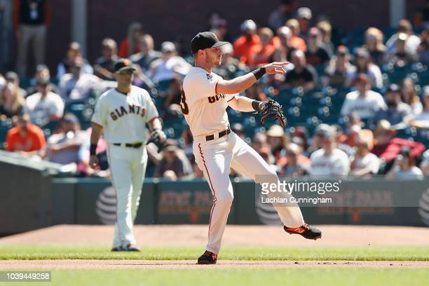 Austin Slater of the San Francisco Giants fields the ball in the second inning against the Colorado Rockies at ATT Park on September 16 2018 in San...