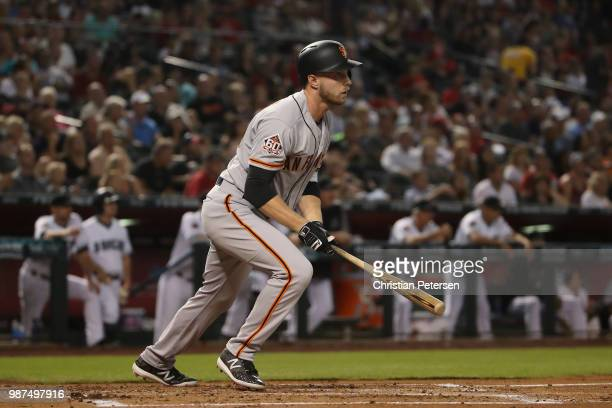 Austin Slater of the San Francisco Giants hits a RBI double against the Arizona Diamondbacks during the second inning of the MLB game at Chase Field...