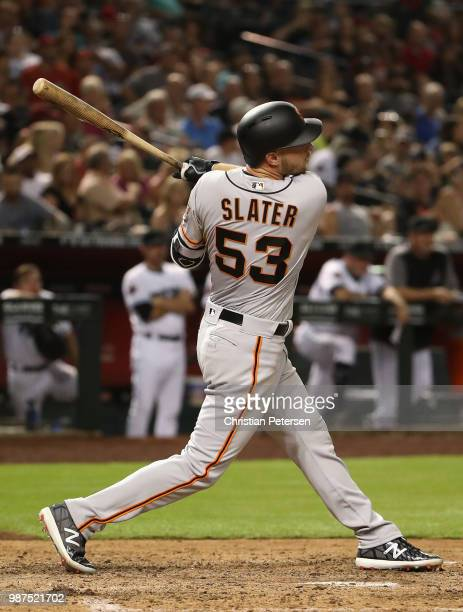 Austin Slater of the San Francisco Giants hits a RBI double against the Arizona Diamondbacks during the seventh inning of the MLB game at Chase Field...