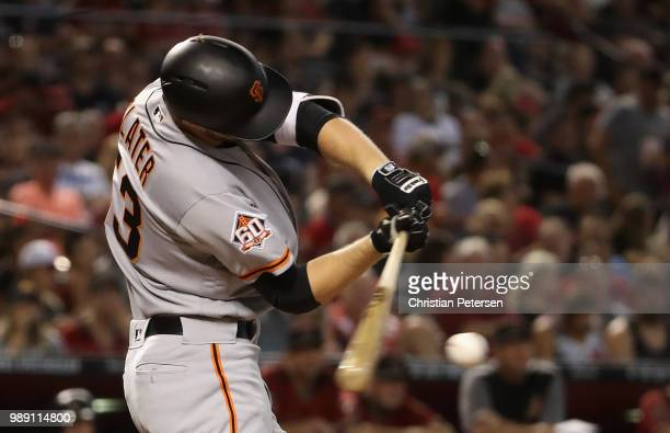 Austin Slater of the San Francisco Giants hits a RBI single against the Arizona Diamondbacks during the third inning of the MLB game at Chase Field...