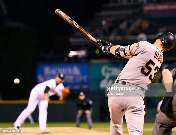 Austin Slater of the San Francisco Giants hits a single in the first inning against the Colorado Rockies on September 5 2018 at Coors Field in Denver...