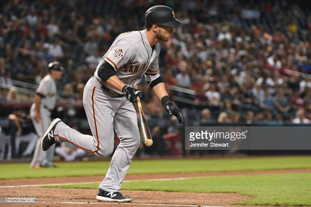 Austin Slater of the San Francisco Giants hits an RBI single during the first inning of the the MLB game against the Arizona Diamondbacks at Chase...