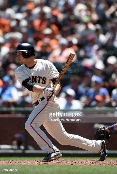 Austin Slater of the San Francisco Giants hits an rbi single to score Brandon Crawford against the Kansas City Royals in the bottom of the fourth...