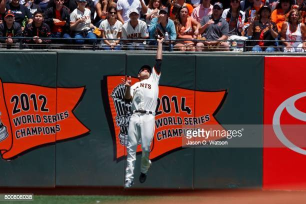 Austin Slater of the San Francisco Giants leaps for and catches a fly ball hit off the bat of TJ Rivera of the New York Mets during the second inning...