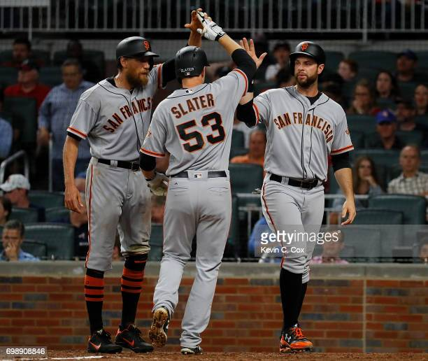 Austin Slater of the San Francisco Giants reacts after hitting a threerun homer to score Brandon Belt and Hunter Pence in the eighth inning against...