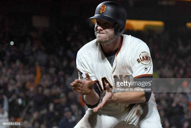 Austin Slater of the San Francisco Giants reacts after scoring against the Colorado Rockies in the bottom of the seventh inning at ATT Park on June...