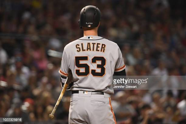 Austin Slater of the San Francisco Giants reacts while at bat in the MLB game against the Arizona Diamondbacks at Chase Field on August 3 2018 in...