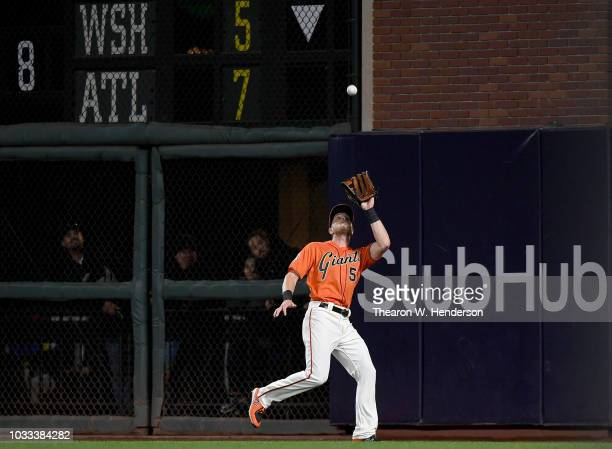 Austin Slater of the San Francisco Giants runs down a fly ball off the bat of Nolan Arenado of the Colorado Rockies in the top of the fourth inning...