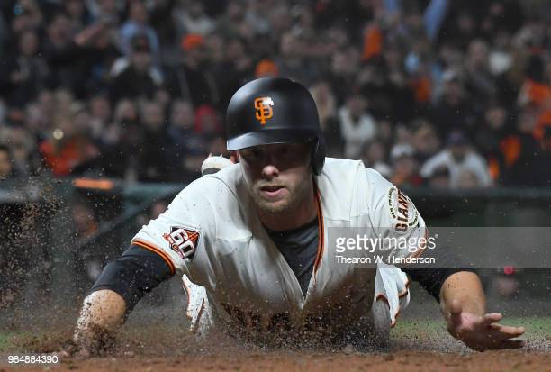 Austin Slater of the San Francisco Giants scores against the Colorado Rockies in the bottom of the seventh inning at ATT Park on June 26 2018 in San...