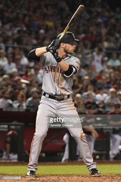 Austin Slater of the San Francisco Giants stands at bat in the MLB game against the Arizona Diamondbacks at Chase Field on August 3 2018 in Phoenix...