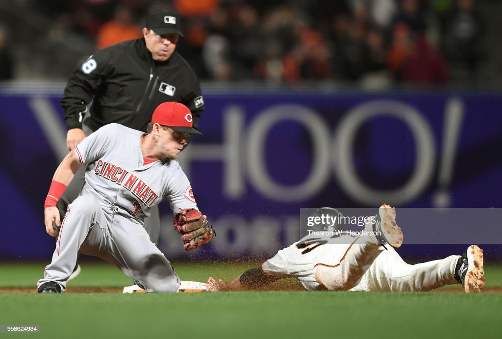 Austin Slater #53 of the San Francisco Giants steals second base sliding in ahead of the tag of Scooter Gennett #3 of the Cincinnati Reds in the bottom of the six inning at AT&T Park on May 14, 2018 in San Francisco, California.