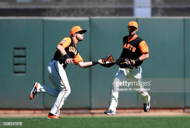 Austin Slater of the San Francisco Giants was charged with an error dropping this ball off the bat of Joey Gallo of the Texas Rangers in the top of...