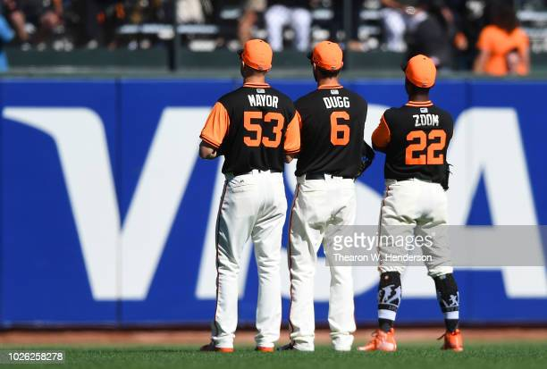 Austin Slater Steven Duggar and Andrew McCutchen of the San Francisco Giants celebrates defeating the Texas Rangers 53 at ATT Park on August 25 2018...