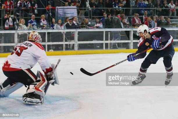 Austin Smith of the USA scores a goal past Chris Dreidger of Canada during the Ice Hockey Classic match between the United States of America and...