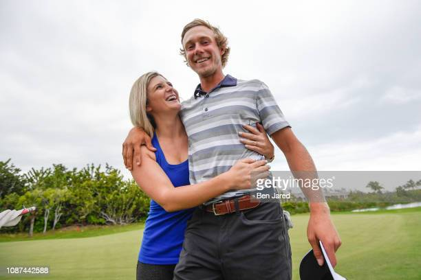 Austin Smotherman and his wife embrace each other during the final round of the Web.com Tour's The Bahamas Great Exuma Classic at Sandals Emerald Bay...