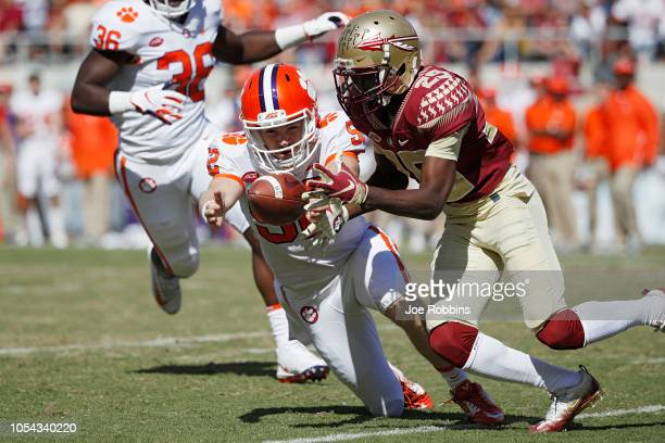 Austin Spence of the Clemson Tigers recovers a fumbled punt by DJ Matthews of the Florida State Seminoles in the third quarter of the game at Doak...