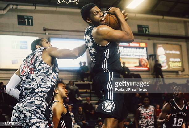 Austin Spurs forward Keith Wright successfully grabs a rebound from the Red Claws basket while Red Claws center Ralph Sampson III tries to regain...