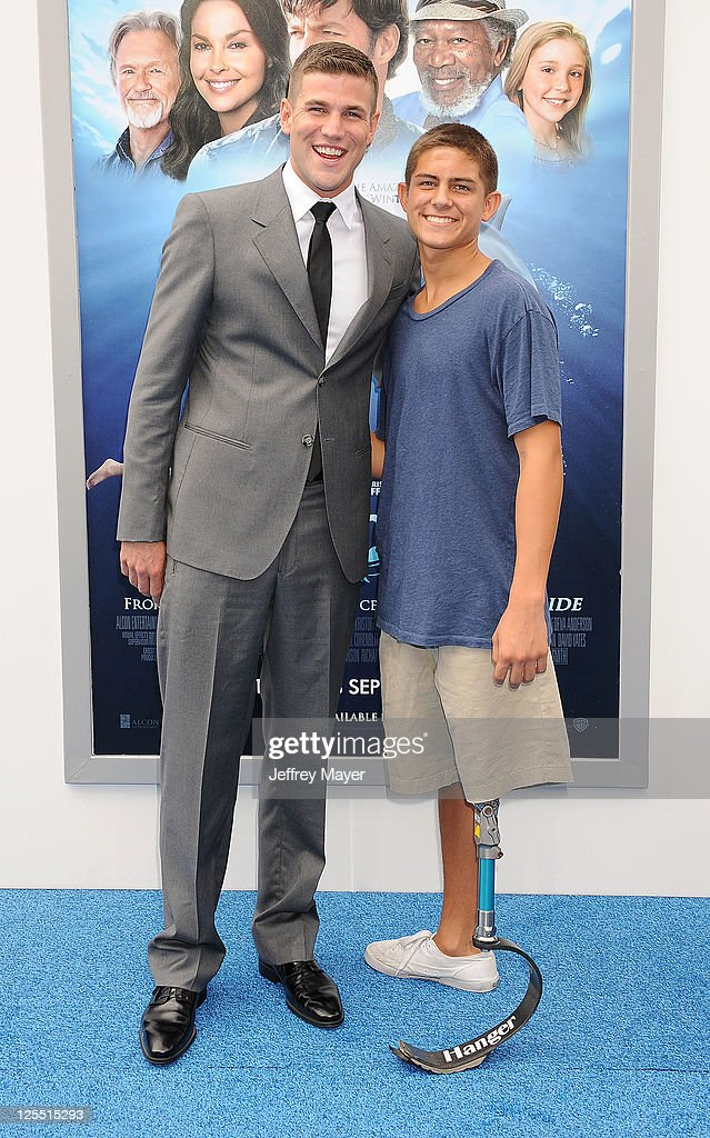 Austin Stowell and Robert Ram attend the 'Dolphin Tale' Los Angeles Premiere at Mann Village Theatre on September 17, 2011 in Westwood, California.