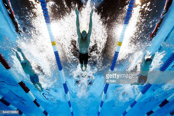 Austin Surhoff Ryan Lochte and Gunnar Bentz of the United States compete in a semifinal heat for the Men's 200 Meter Individual Medley during Day...