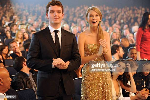 Austin Swift and singer Taylor Swift onstage at the 2011 American Music Awards held at Nokia Theatre LA LIVE on November 20 2011 in Los Angeles...