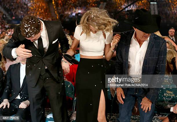 Austin Swift recording artist Taylor Swift and recording artist George Strait attend the 49th Annual Academy of Country Music Awards at the MGM Grand...