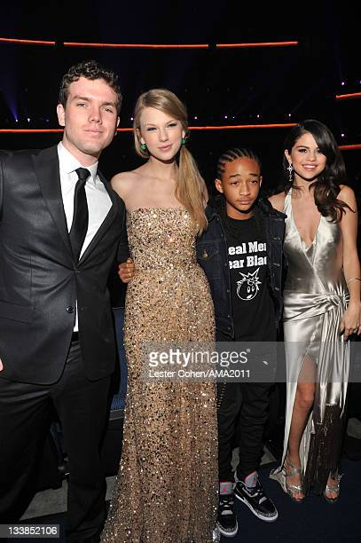 Austin Swift singer Taylor Swift actor Jaden Smith and singer Selena Gomez at the 2011 American Music Awards held at Nokia Theatre LA LIVE on...