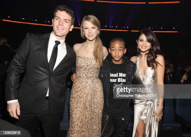 Austin Swift singer Taylor Swift actor/musician Jaden Smith and singer Selena Gomez at the 2011 American Music Awards held at Nokia Theatre LA LIVE...