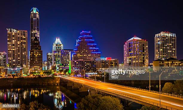 austin texas evening excitement cityscape, skyline, skyscrapers, congress avenue bridge - austin texas stock pictures, royalty-free photos & images